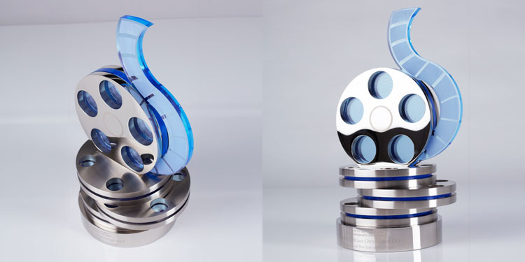 Custom-designed NFTS award featuring film reel; made in aluminium and acrylic