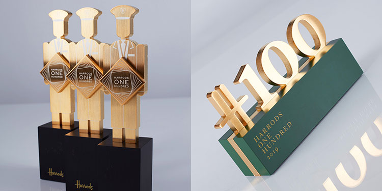 Harrods 100 staff recognition custom trophies featuring doormen and logo
