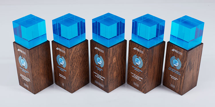 Engraved wooden awards, clear blue cap
